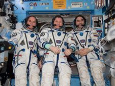 Three members of the Expedition 34<br /> crew pose for some photographs in<br /> their Sokol suits in the Destiny lab.<br /> Credit: NASA